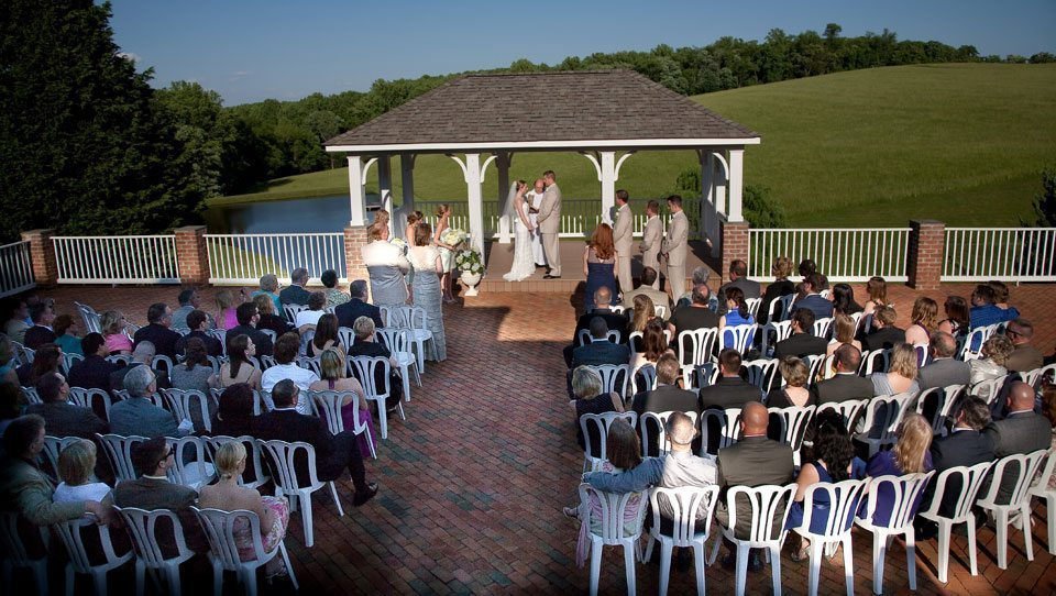 Couple exchanges vows on pavilion at Mornigside Inn an outdoor wedding venue in Frederick Maryland