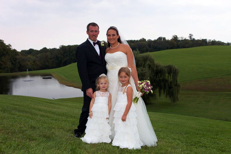 Bride, groom, and flower girls