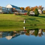 Wedding Venue in Maryland, Morningside Inn, bride and groom on back lawn with reflection of lake
