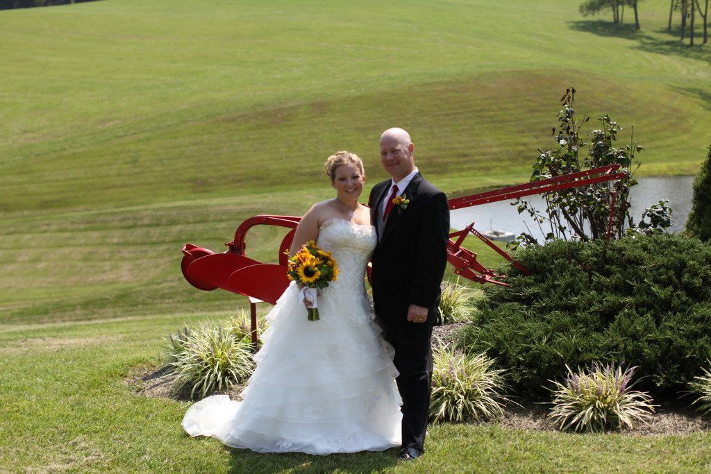 Bride and groom by plow