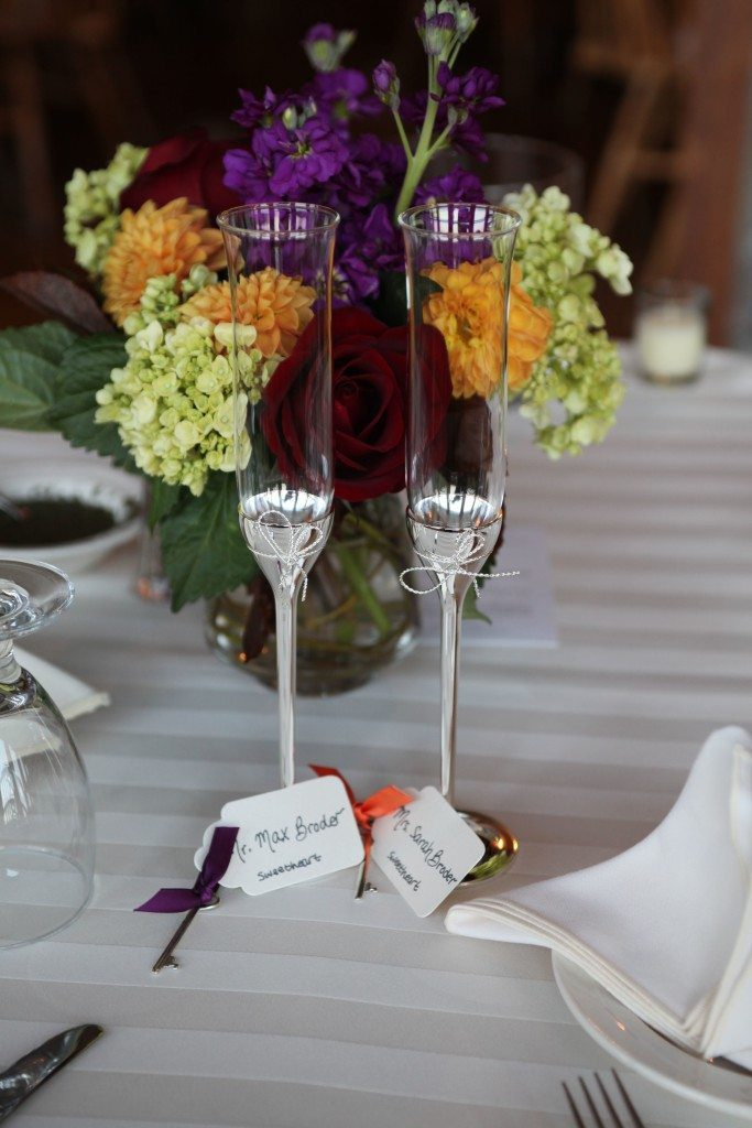 head table with bride and groom champagne flutes
