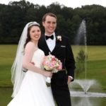 Bride and Groom pose for photograph after wedding ceremony in Maryland by the pond fountain at Morningside Inn country wedding venue in Maryland
