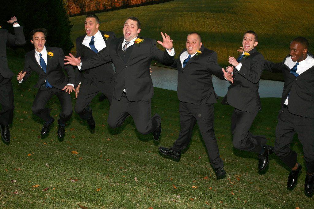 Groomsmen jump at Kerry & Jacob's Fall Outdoor Wedding