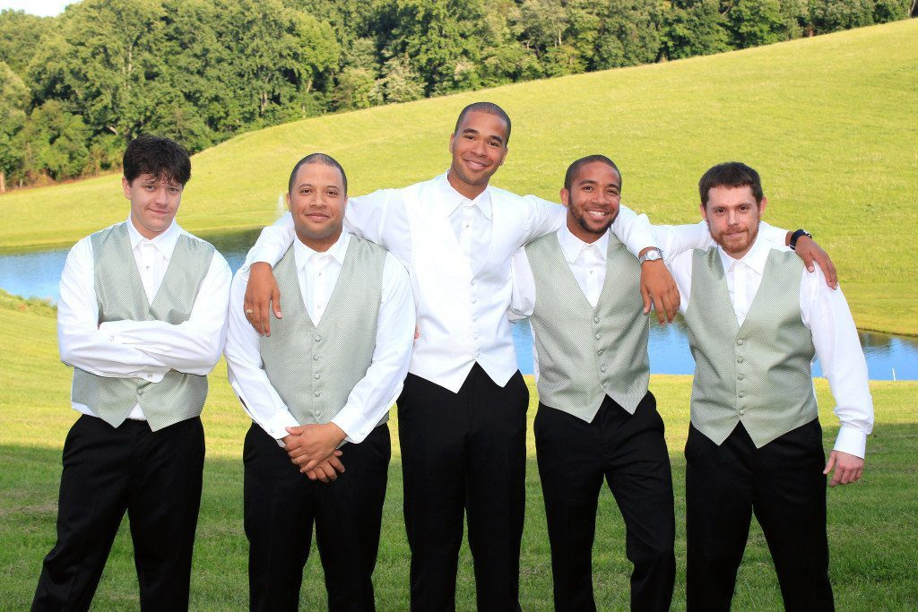Groom and groomsmen pose by pond at Morningside Inn Maryland