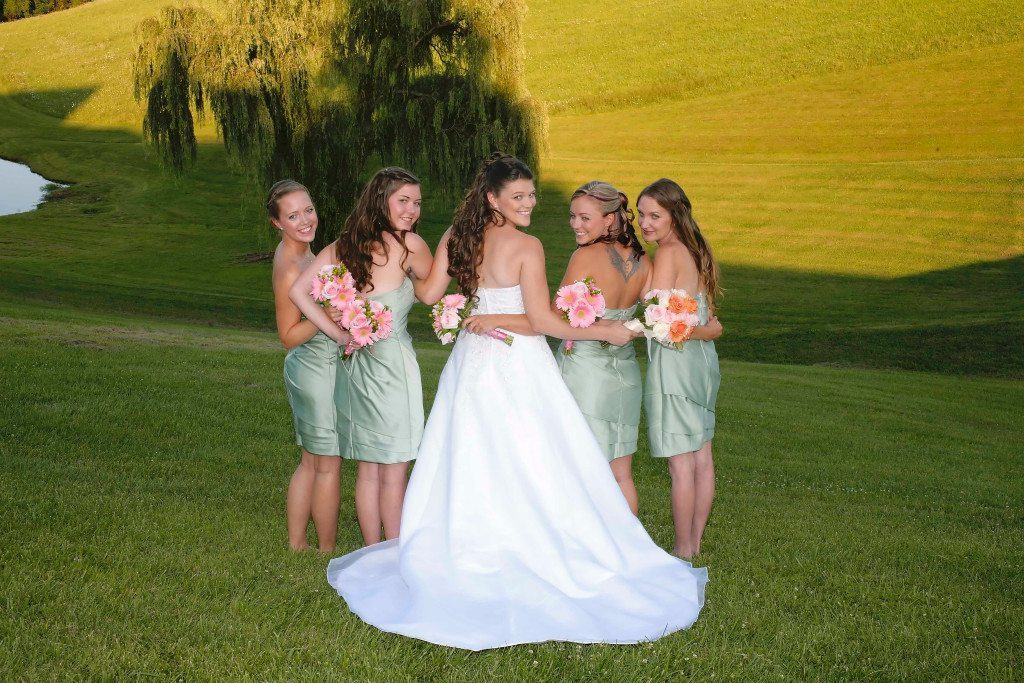 Maryland wedding site with bride and bridesmaids by pond
