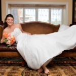 Bride's pose for maryland wedding on the unique sofa in Bride's room at Morningside Inn