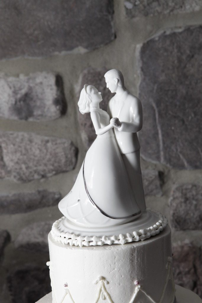 Wedding cake topper with bride and groom dancing white ceramic