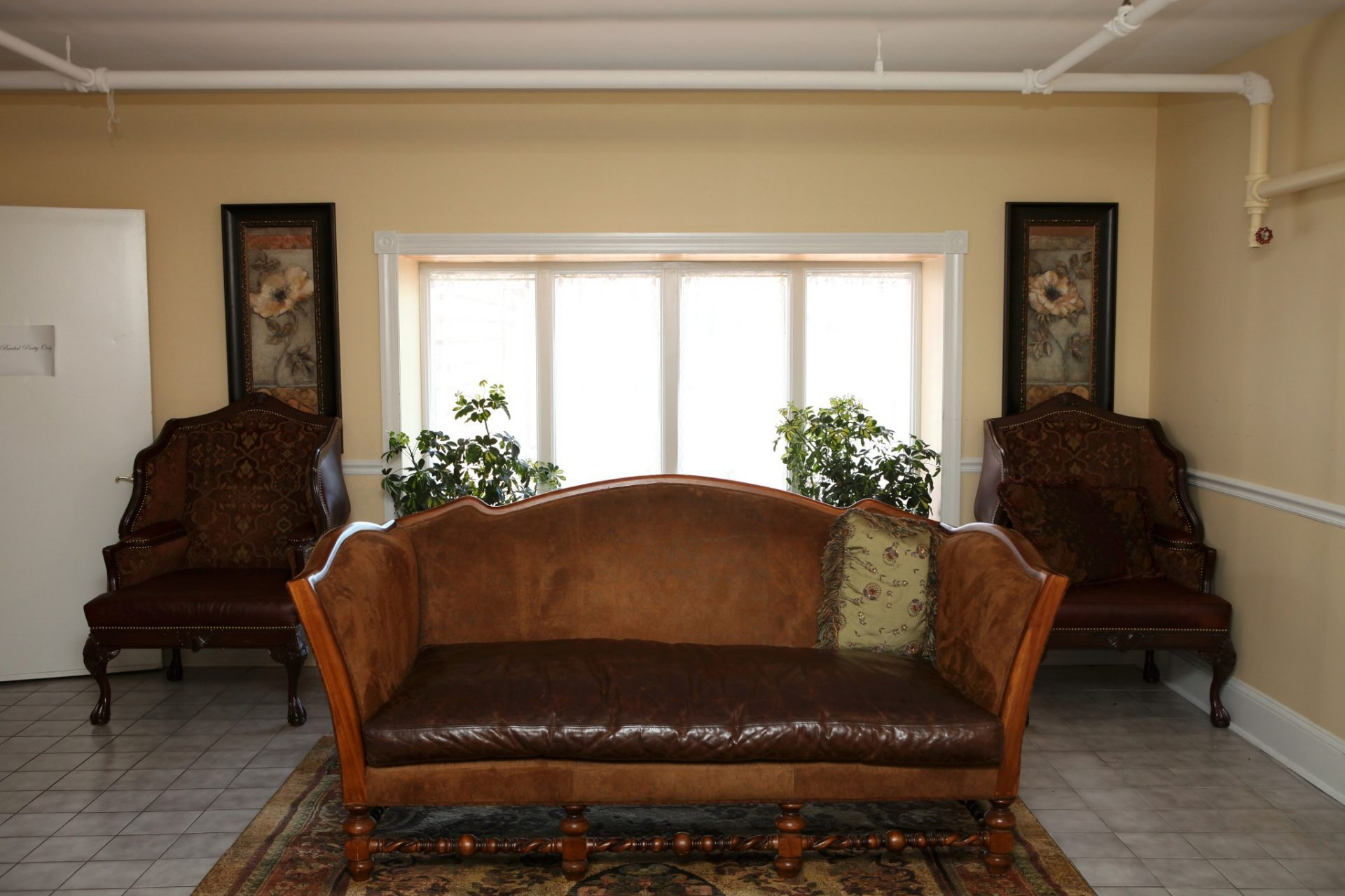 Brides room single leather couch