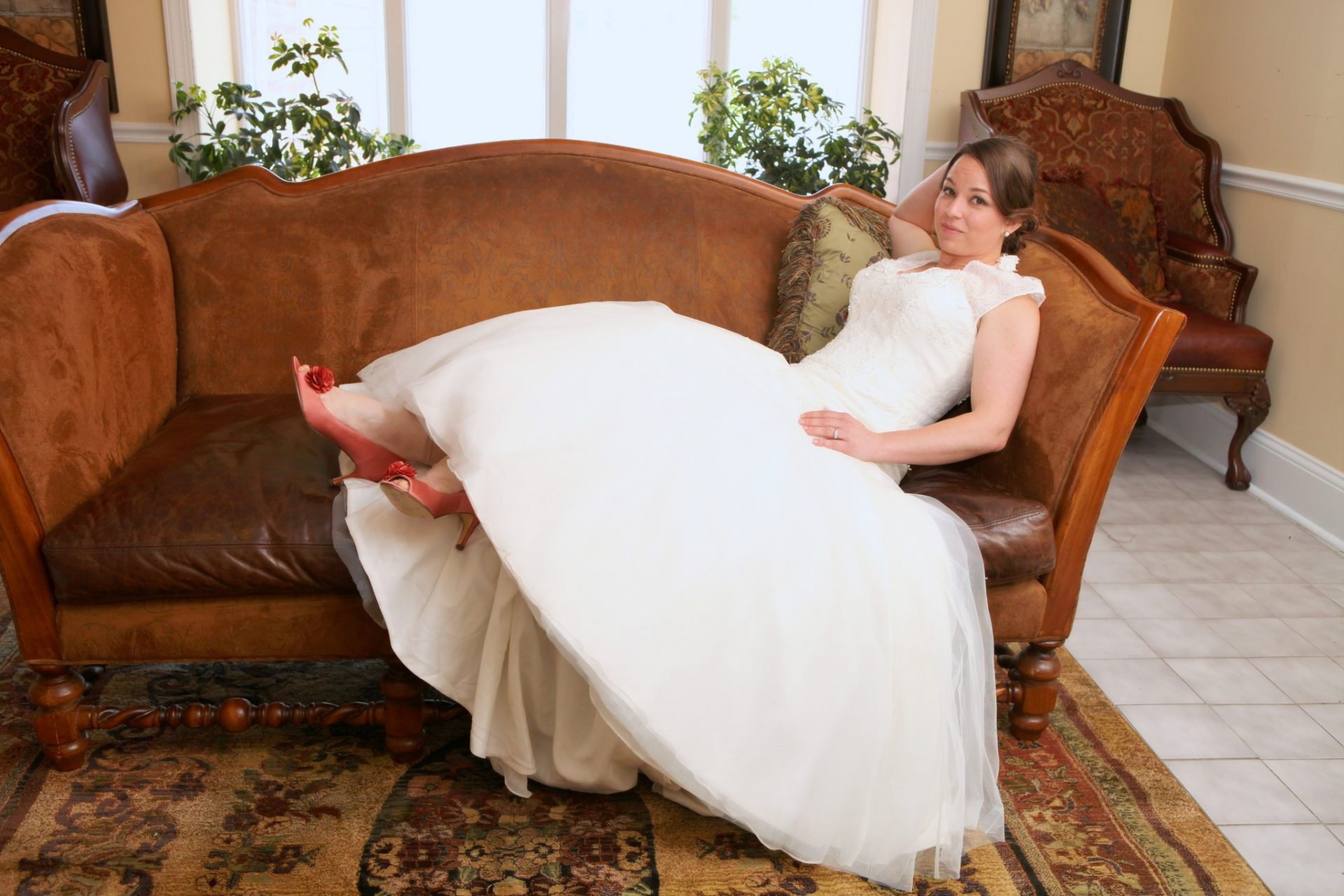 Reception bride on large leather couch