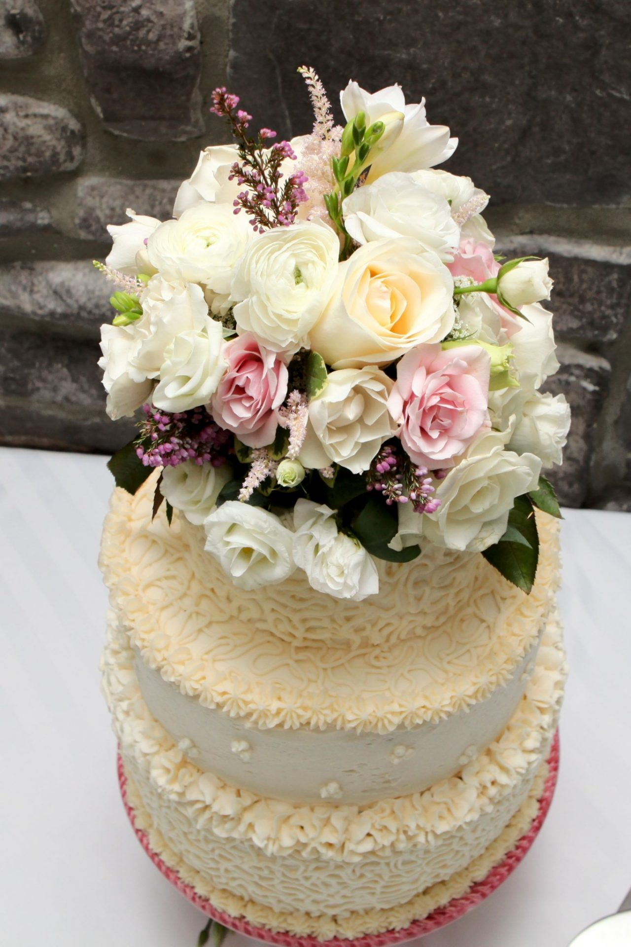 wedding cake topped with flowers