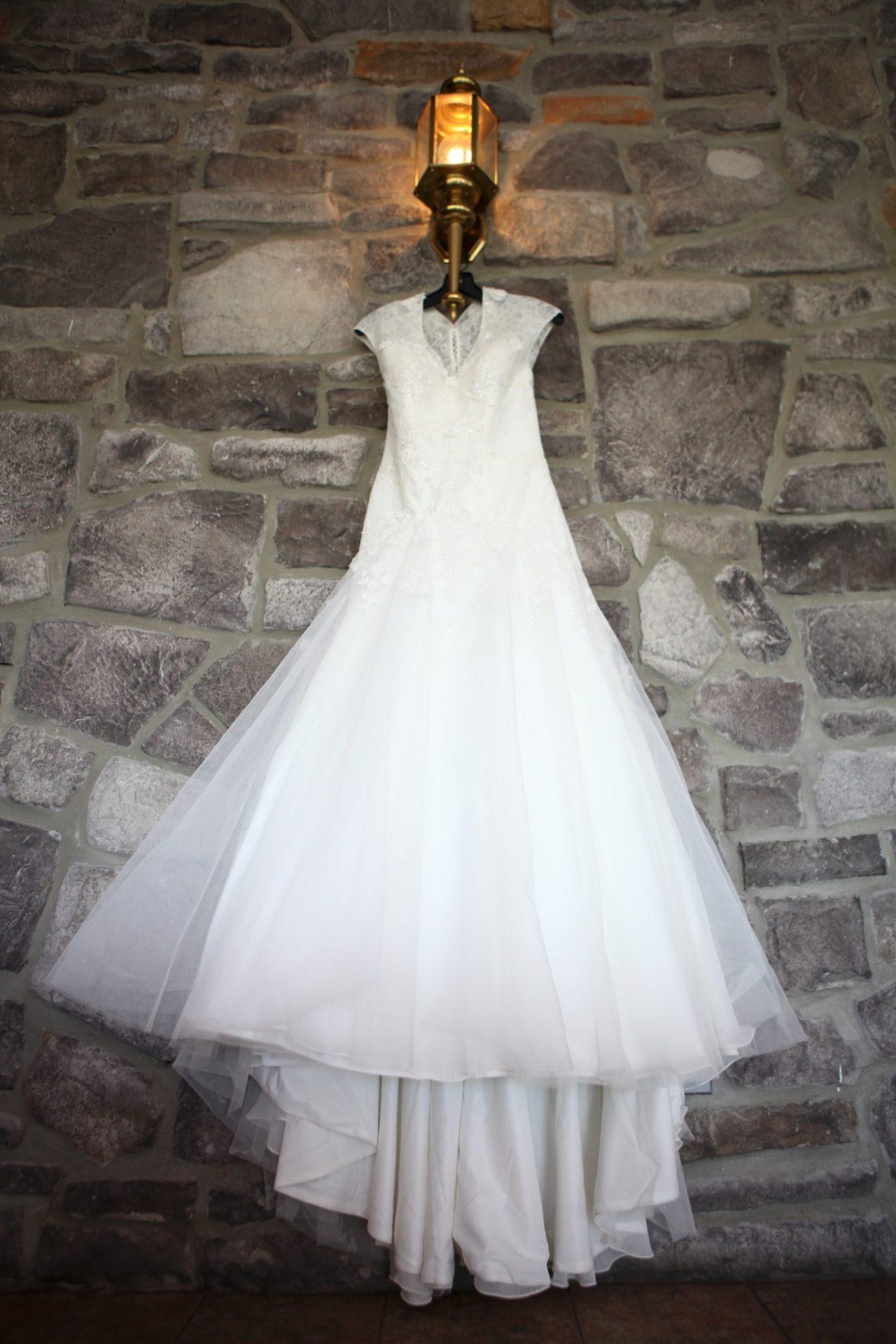Wedding Reception wedding dress against stone wall
