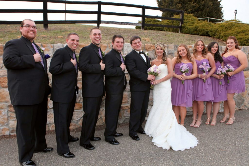 bridal party in front of stone wall at morningside inn outdoor wedding venue located in frederick maryland