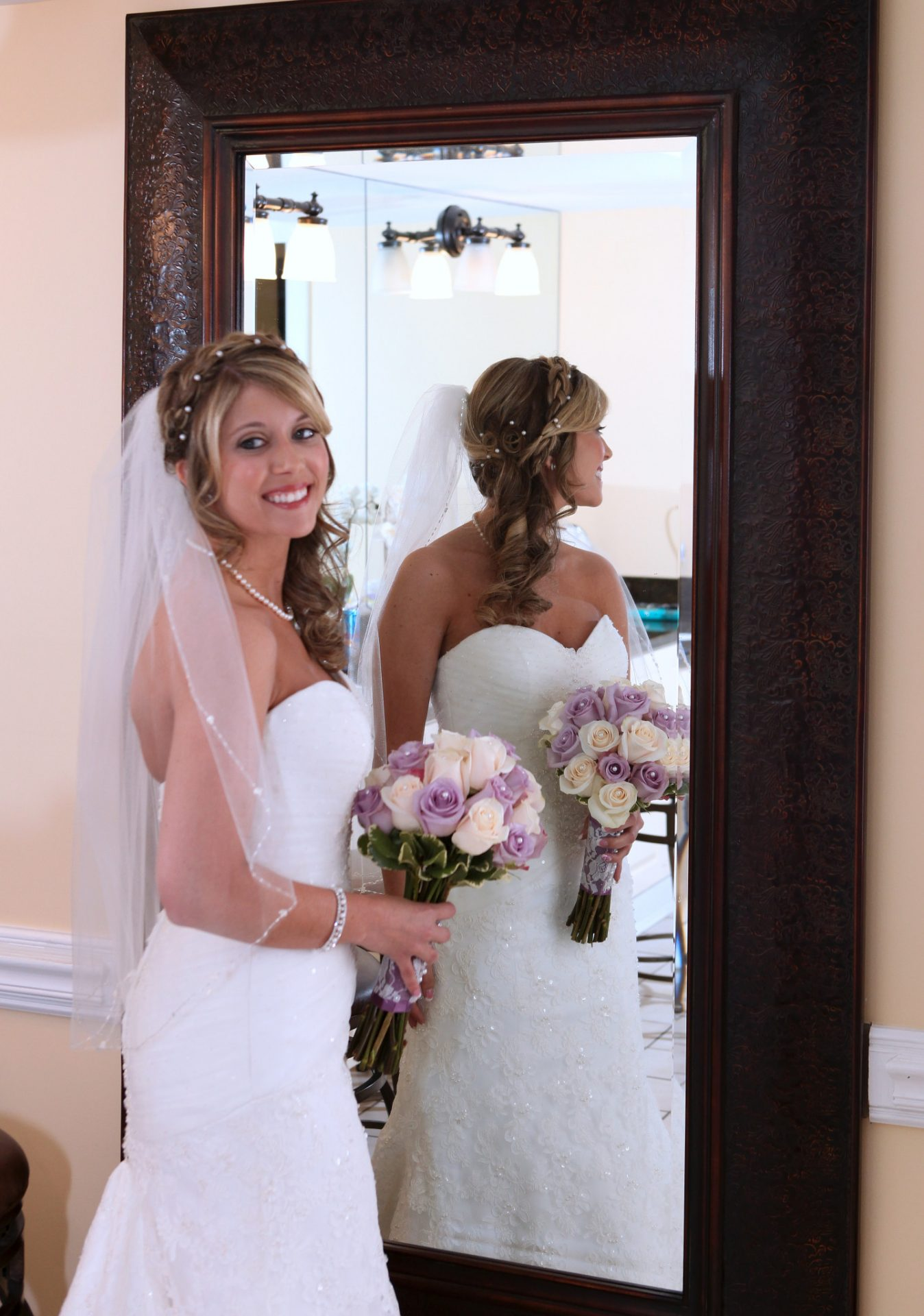 bride in front of mirror in bride's room
