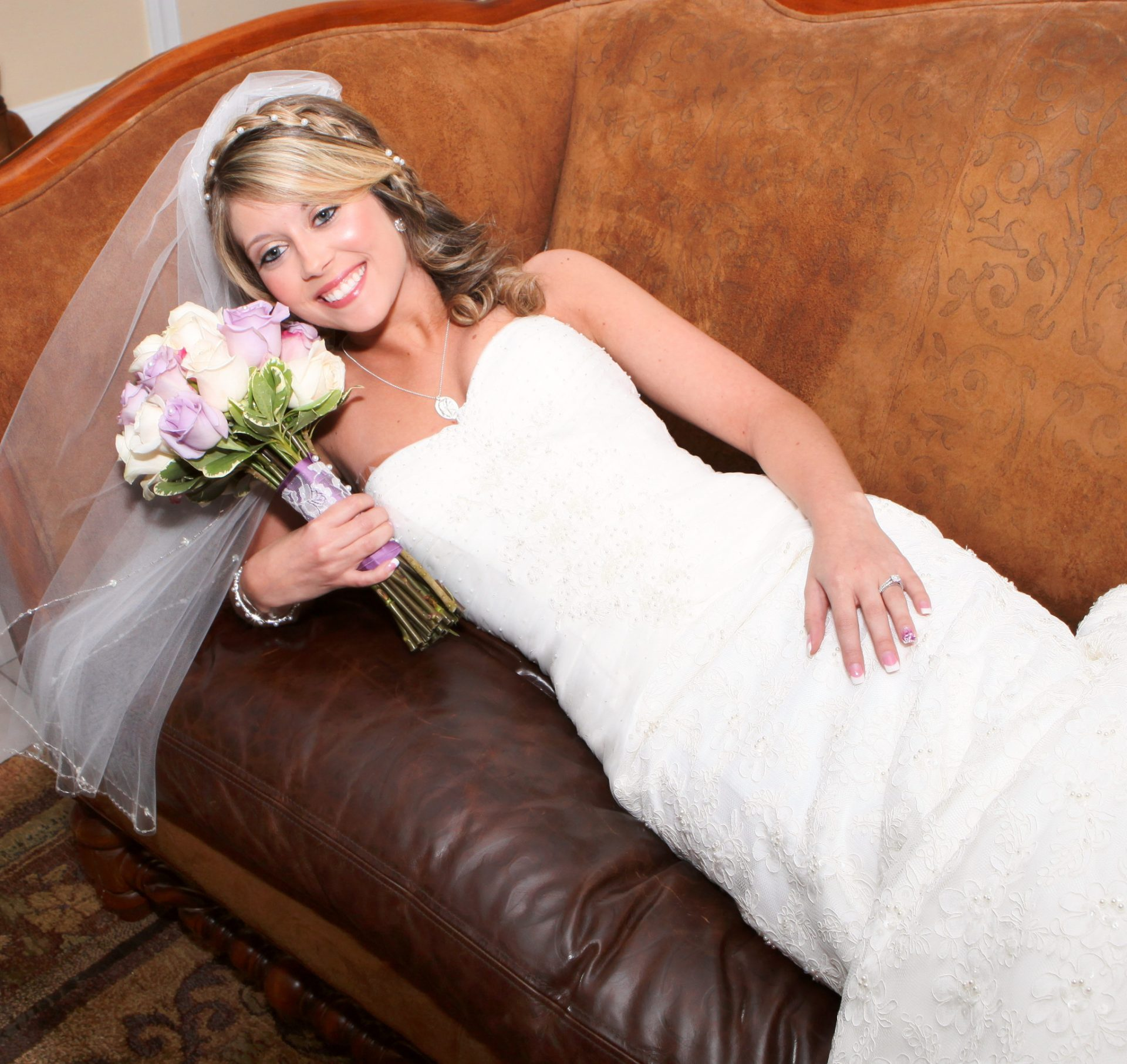 Bride's room at morningside inn with bride laying on leather couch