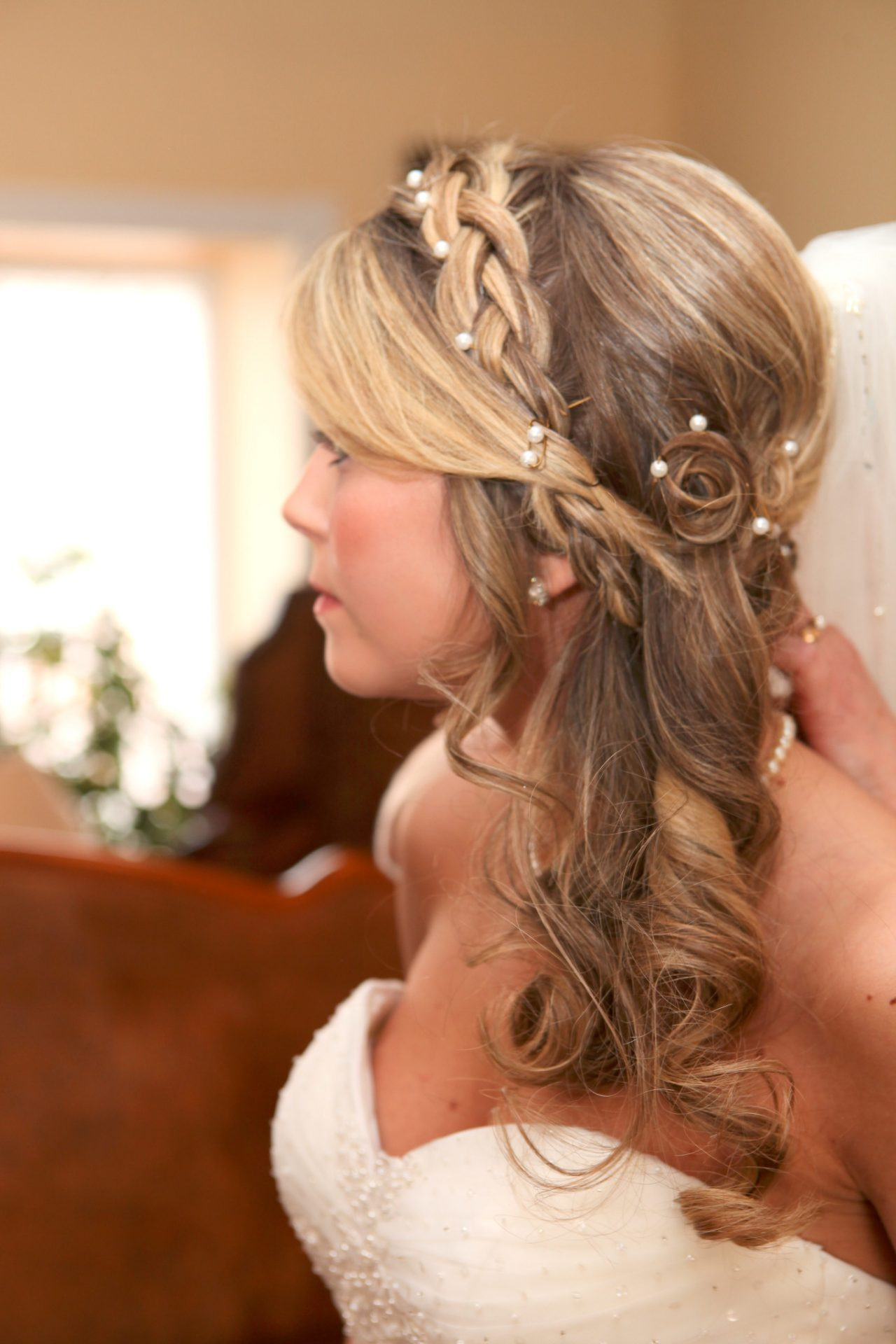 Bride's hair style with light curls and braids