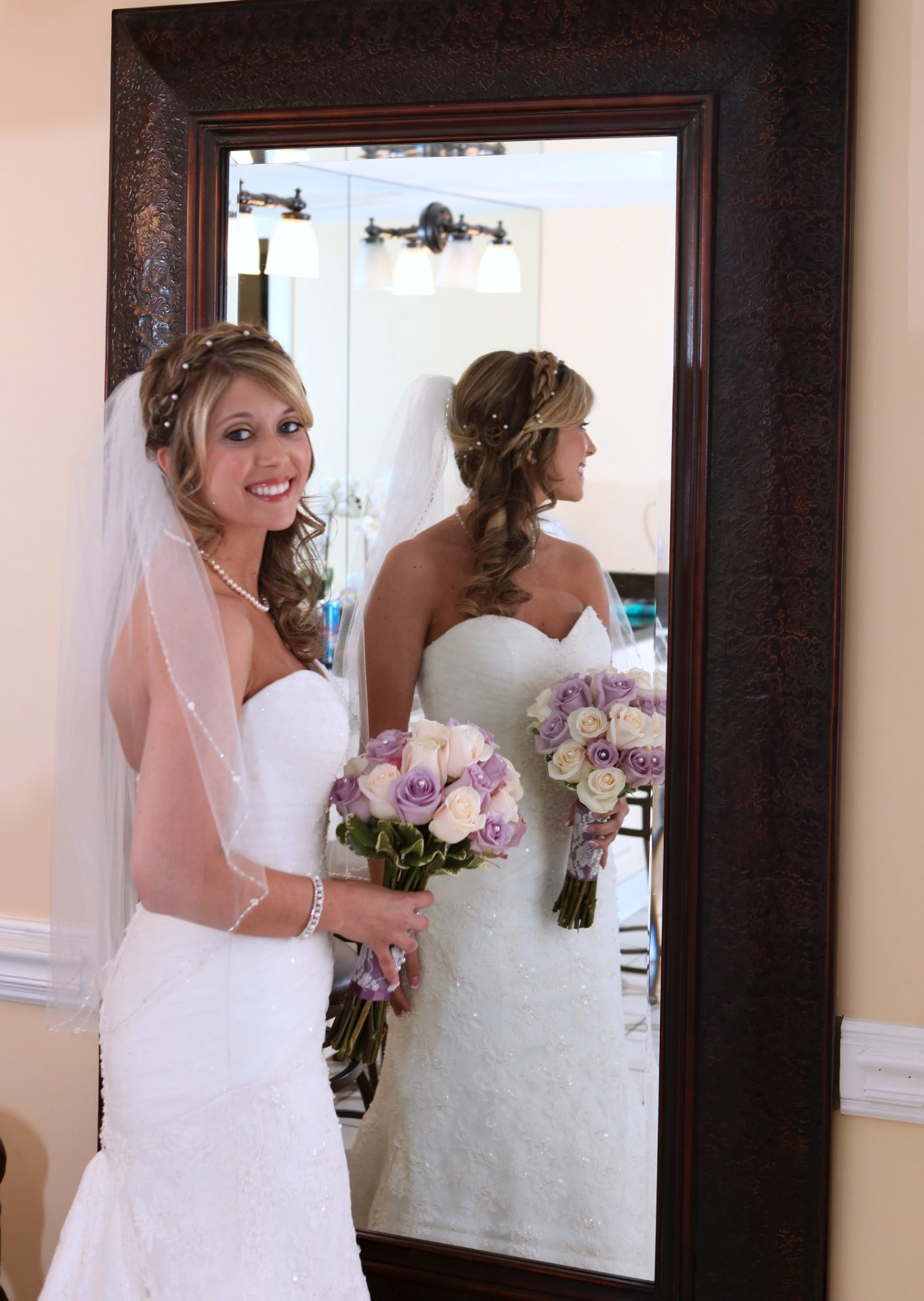 Bride standing in front of large mirror in bride's room at morningside inn