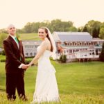 Bride and groom posing in the field behind Morningside Inn after their spring wedding in Frederick, Maryland