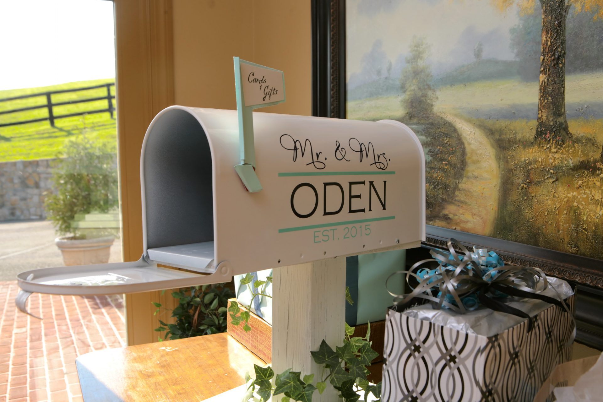 wedding message mailbox painted white with Mr. and Mrs Oden painted on side