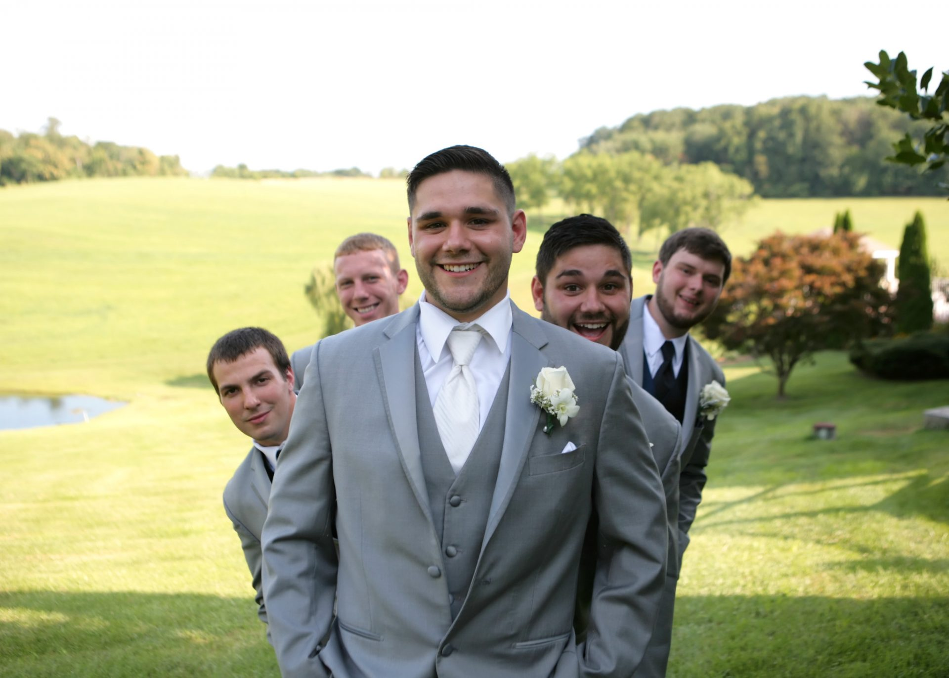 groomsmen on the back lawn during spring wedding in Maryland