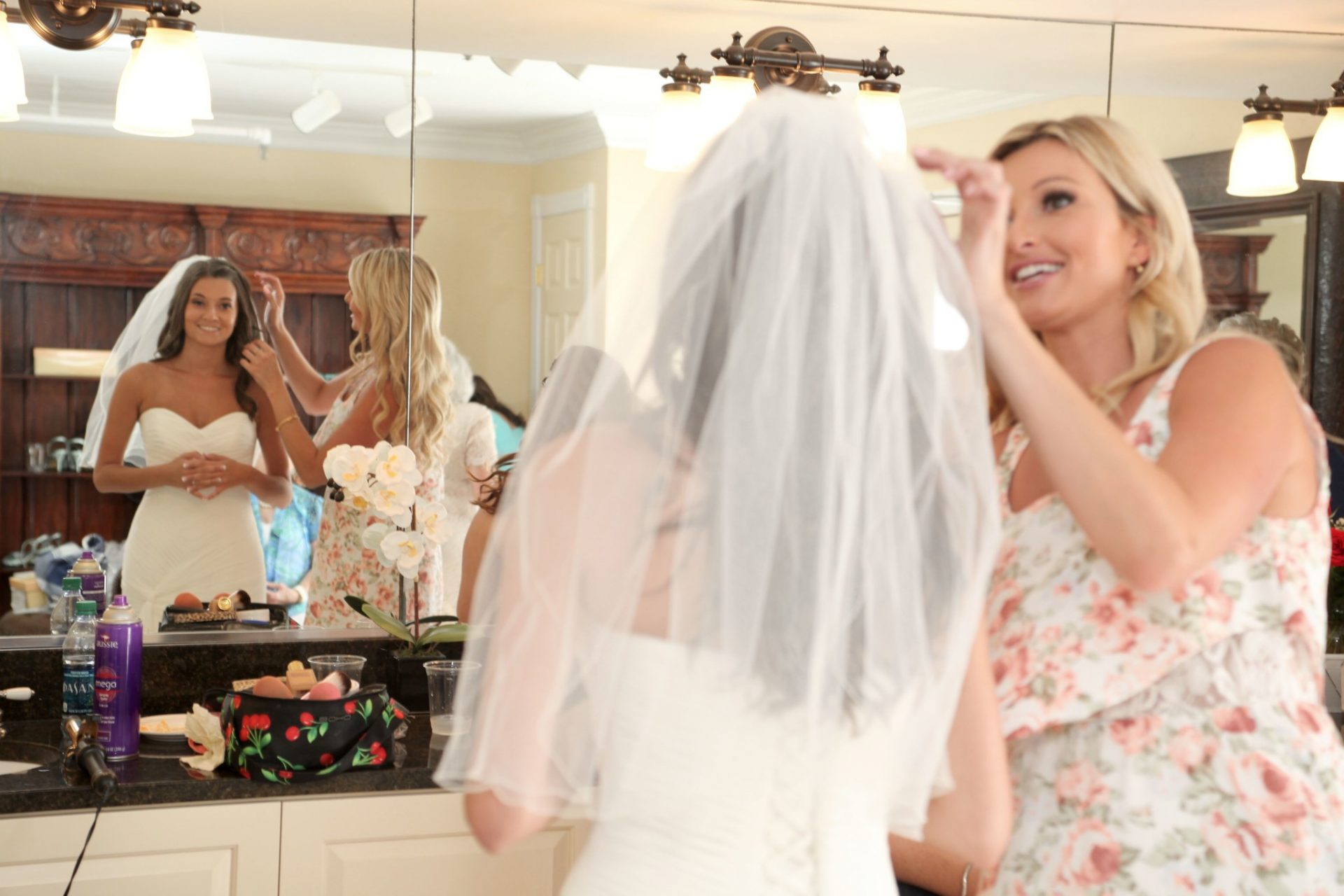 Bridal party prepares for wedding in the brides room