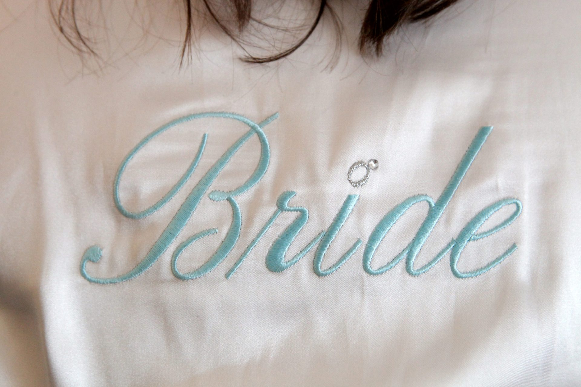 "Bride's robe with embroidered ""bride"" on the back"