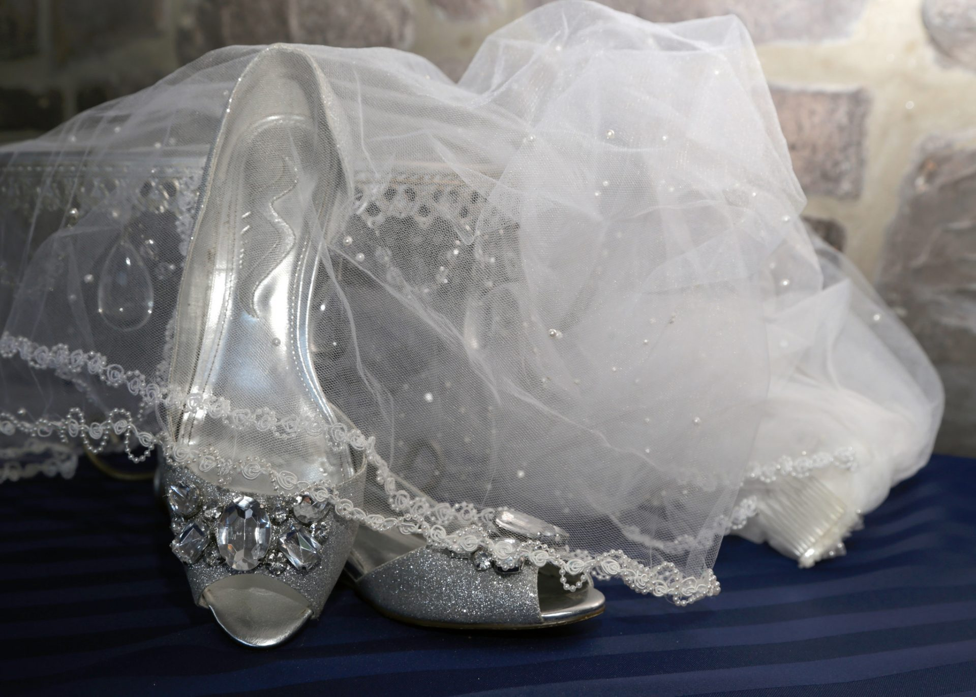 Kristin's veil and wedding shoes before her outdoor wedding