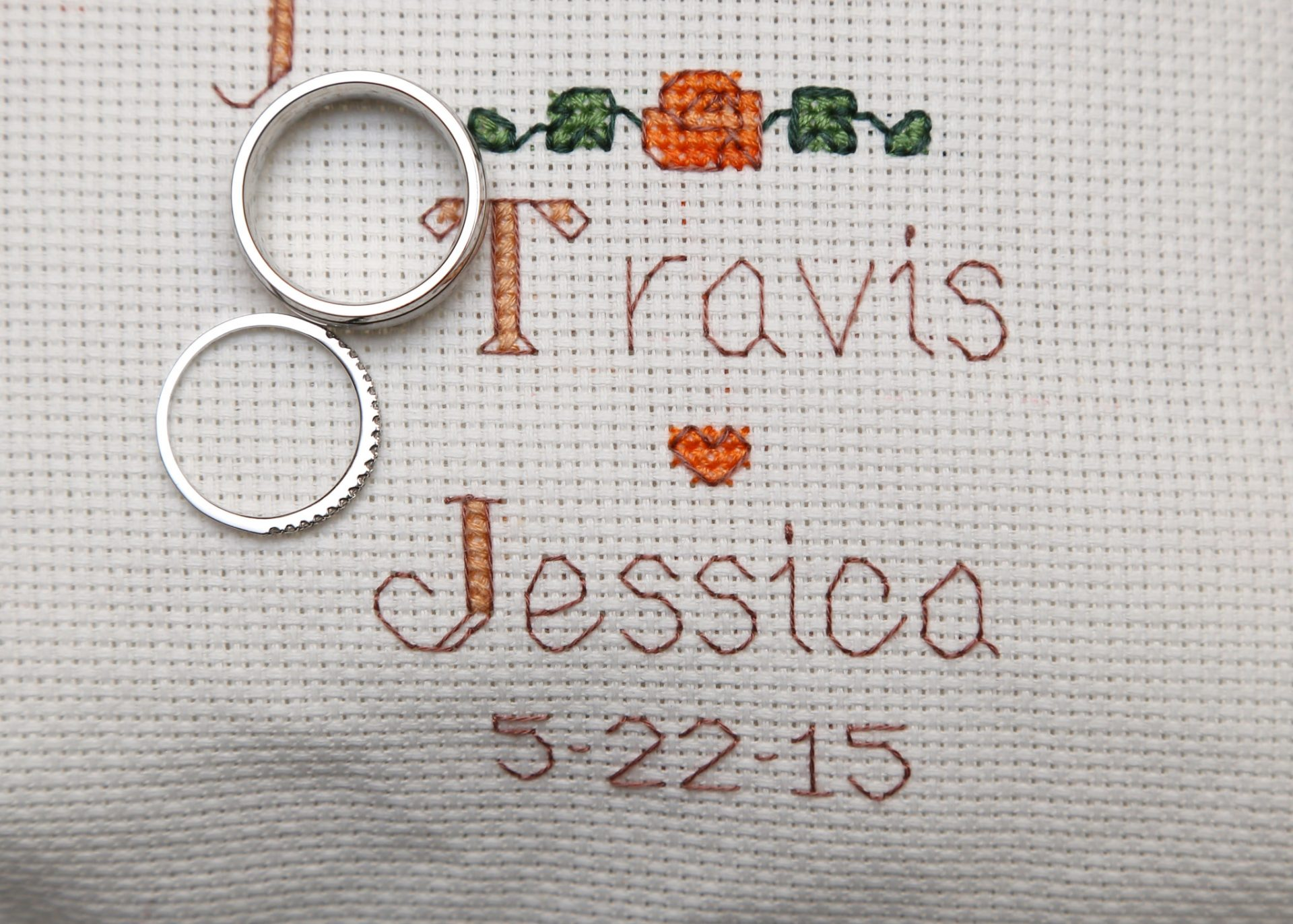 hand made wedding gift of cross stitched pillow with name of bride and groom and date of wedding