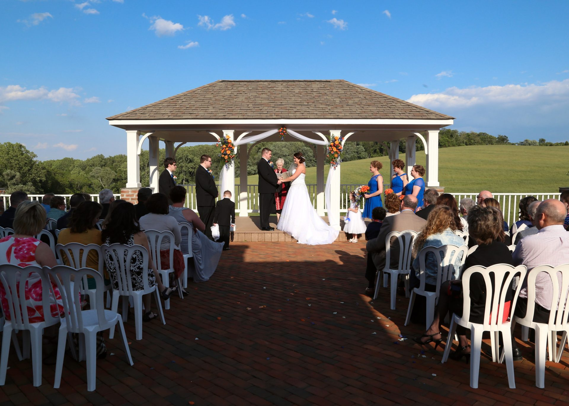 Outdoor wedding in Maryland on brick patio and pavilion