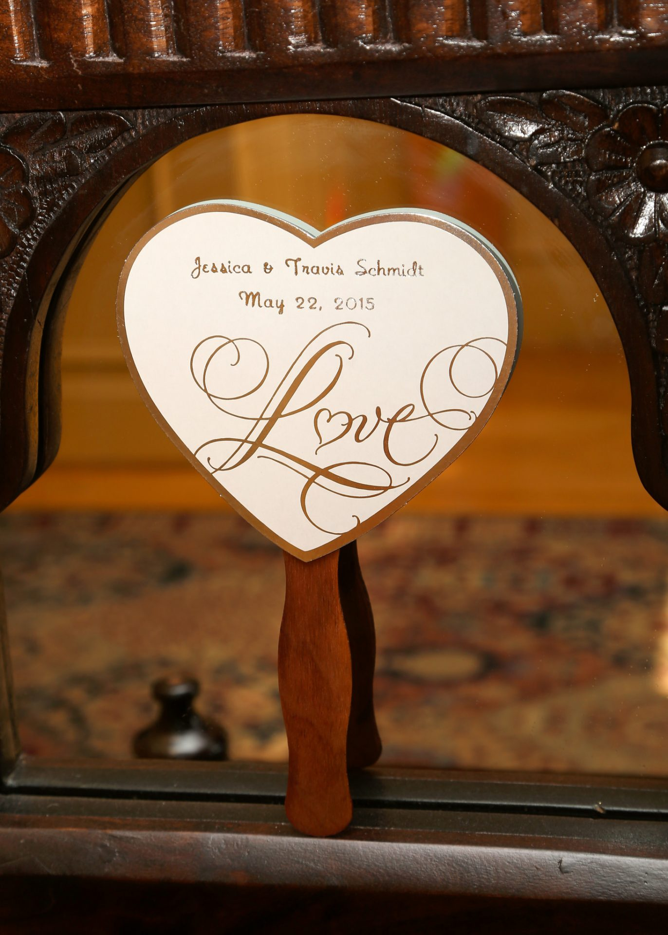 heart shaped fan used during outside wedding ceremony