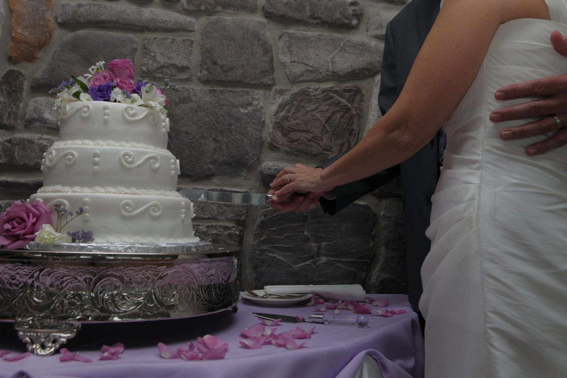 Bride and groom cut the cake during their wedding reception at Morningside inn