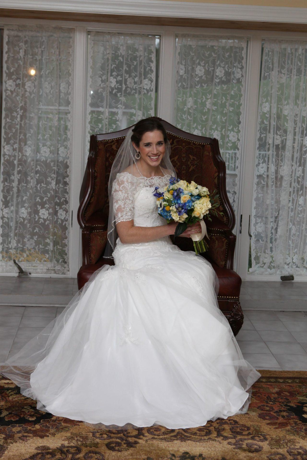 Bride posing in large bride's room before her wedding in Maryland