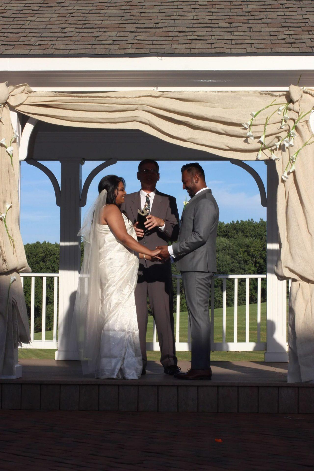 Bride and Groom on wedding pavilion