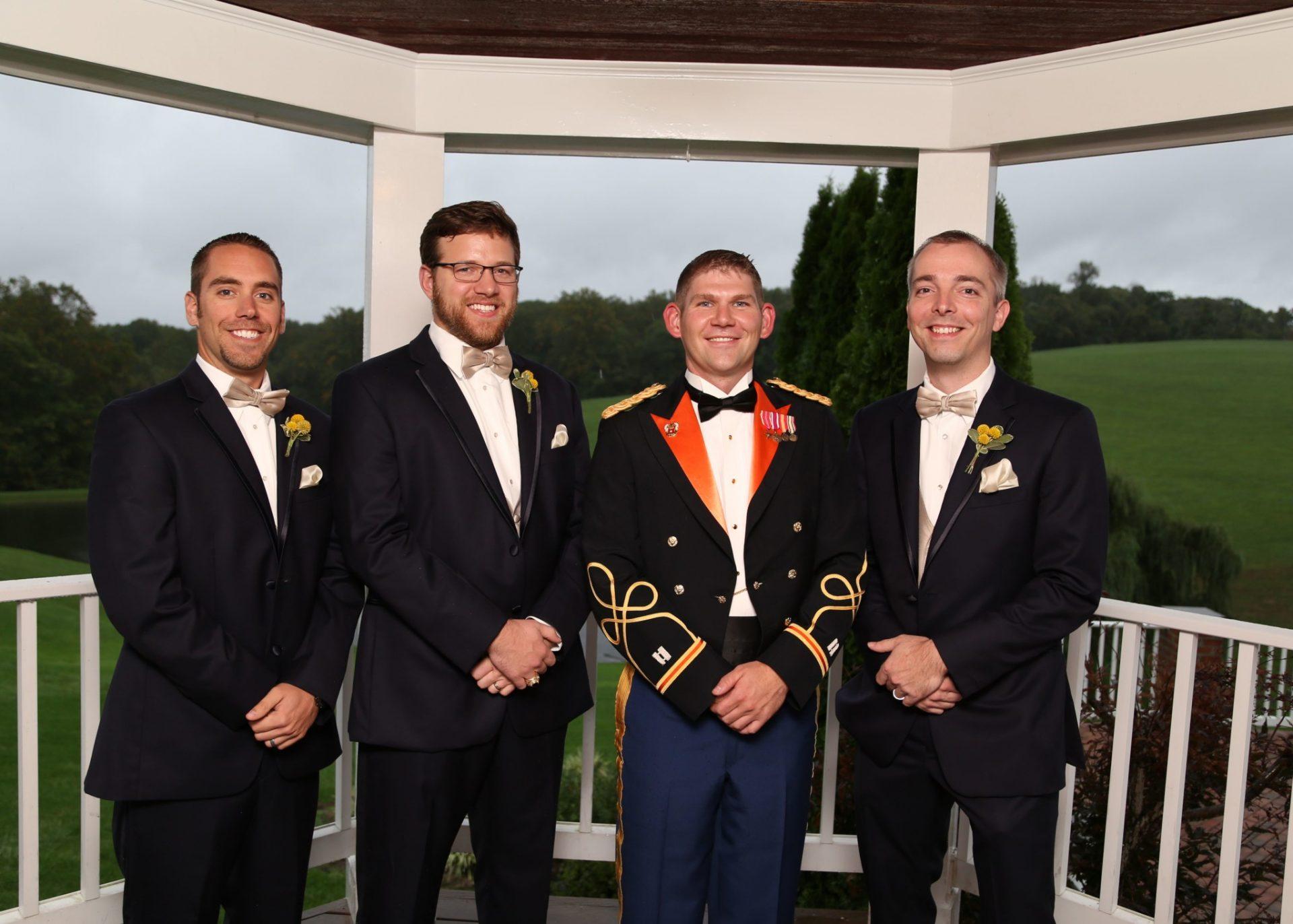 Groom and groomsmen pose on the gazebo at Morningside Inn before their wedding in Md