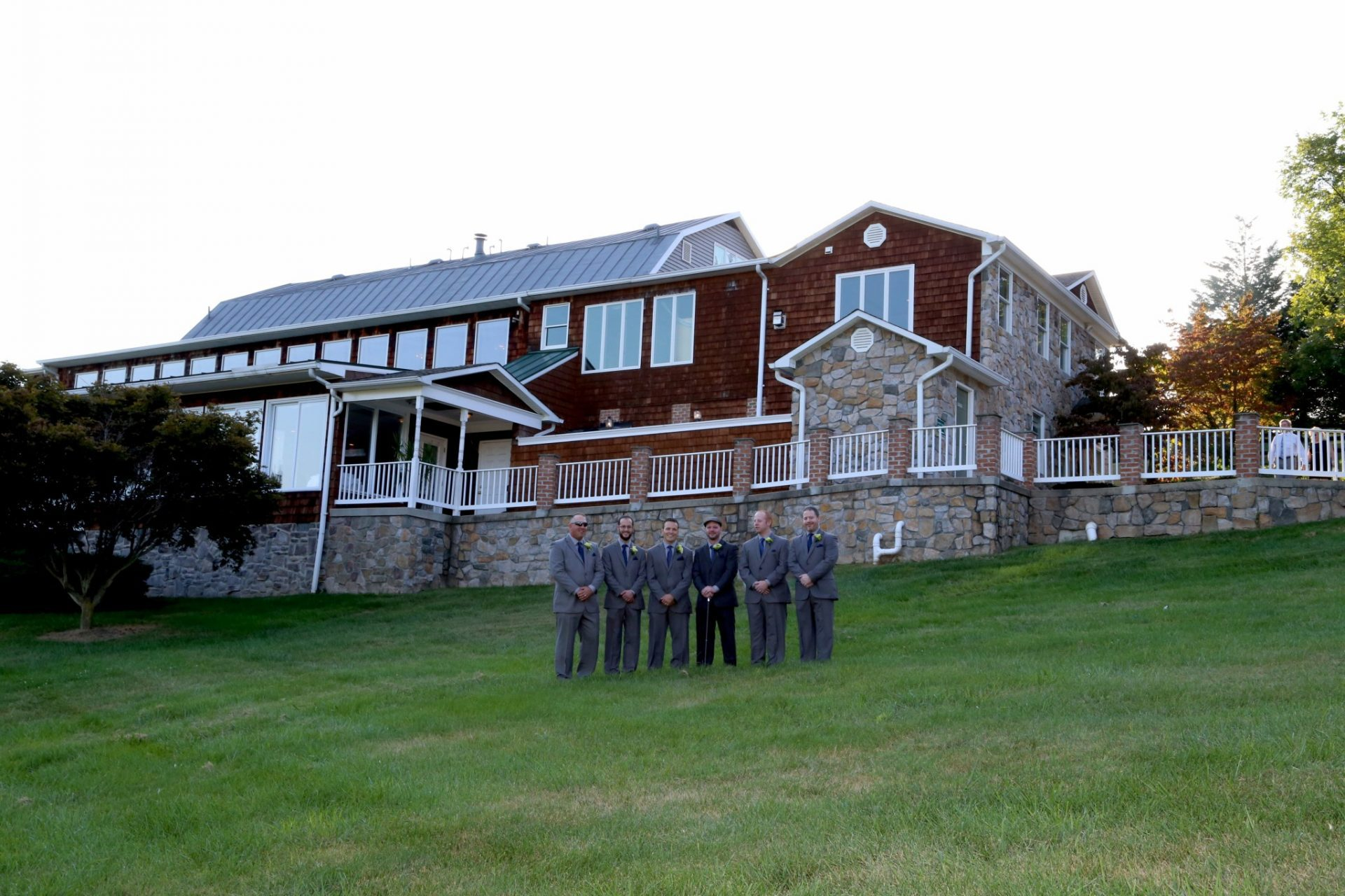 At Maryland wedding venue Groomsmen line up on lawn outside of groom's room at country wedding venue in Frederick Maryland