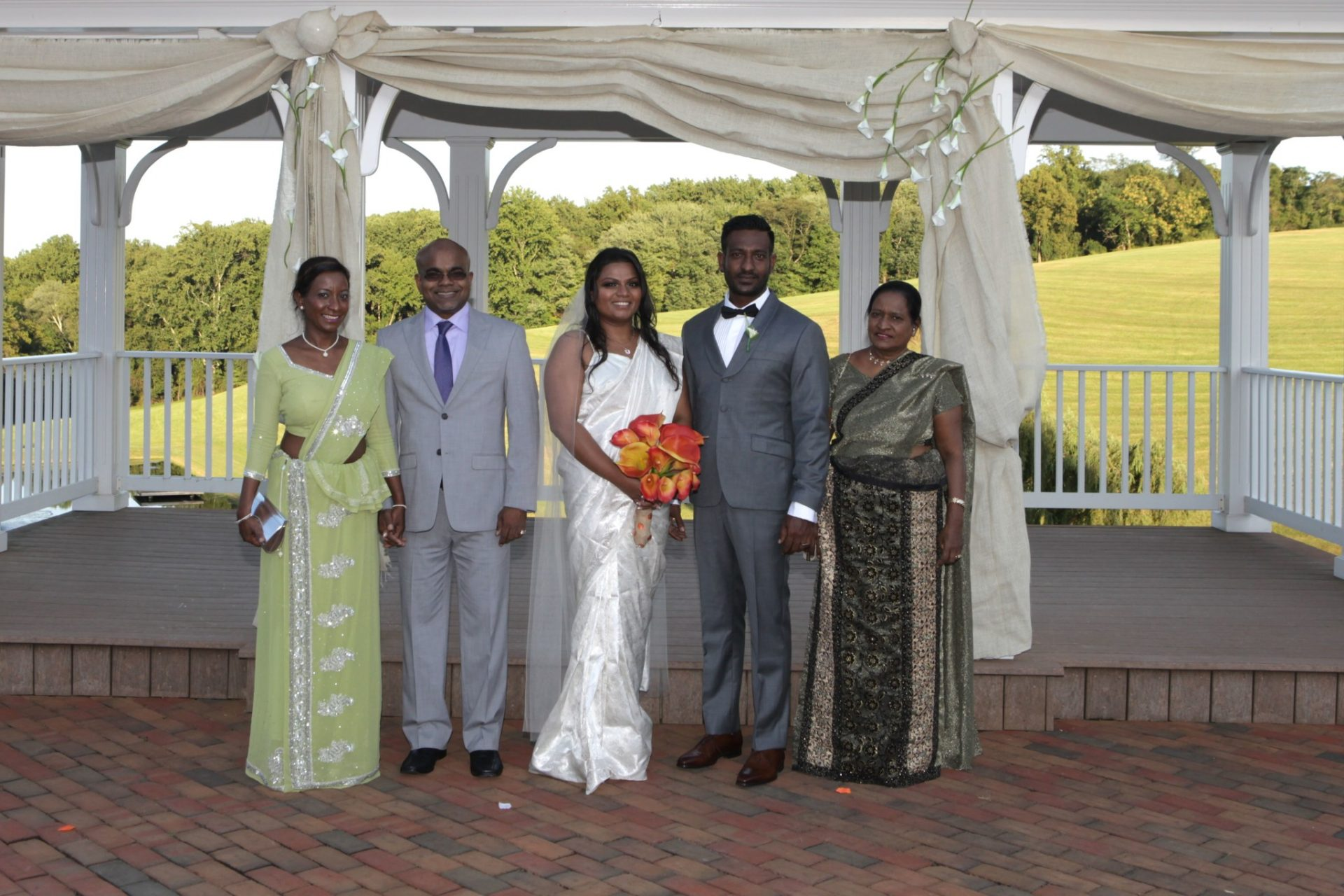 Family photograph in front of wedding pavilion
