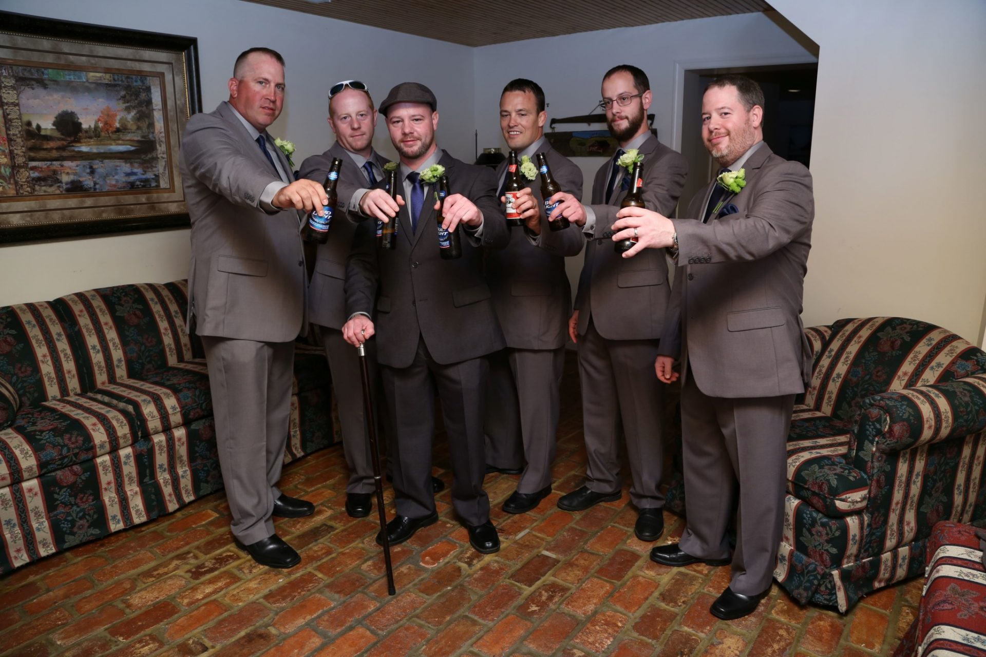 Celebrating in the groom's room before Maryland wedding