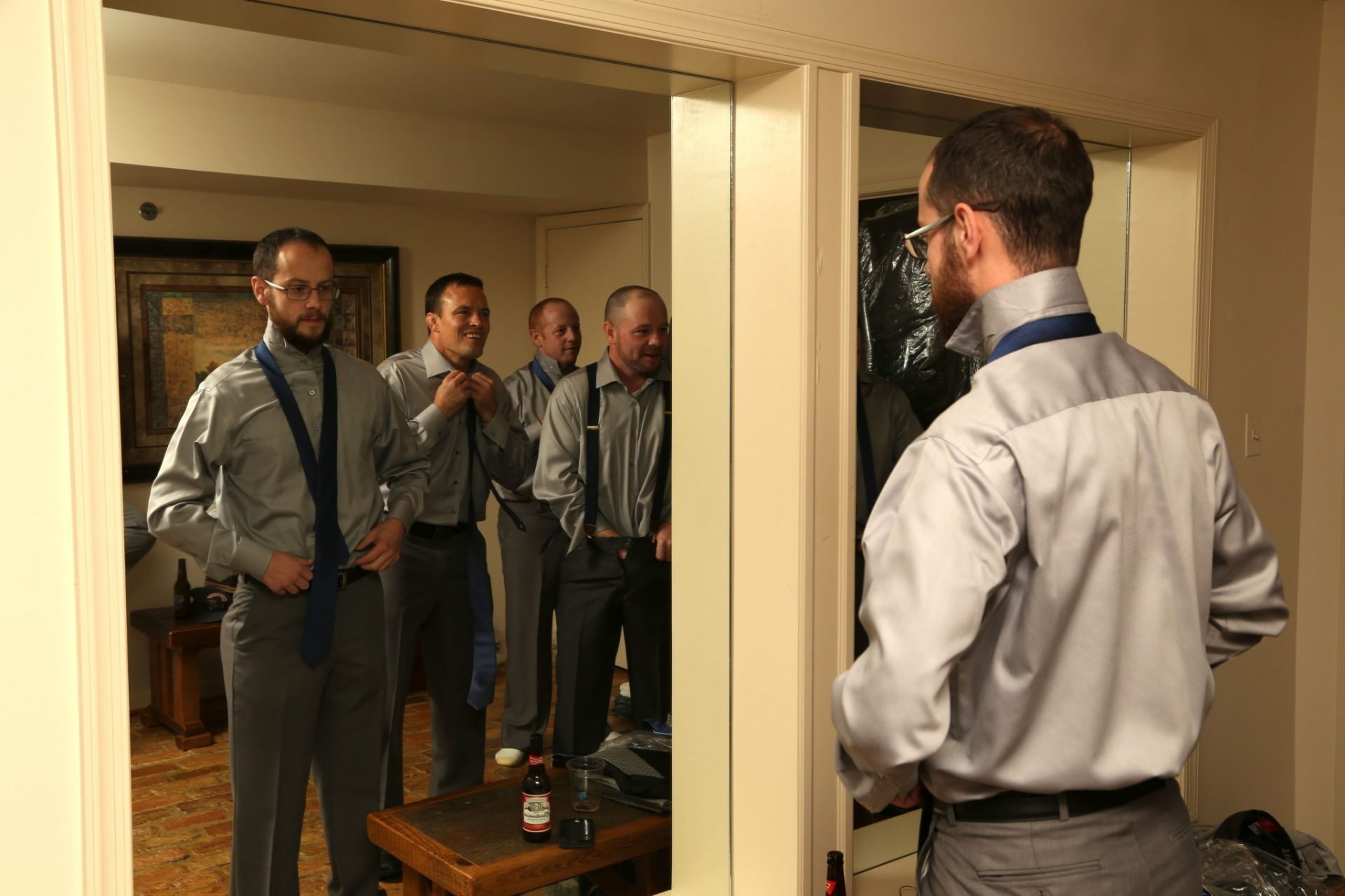 Large mirrors make wedding preparations easy for groom and groom's men