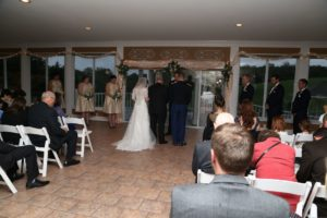 Due to weather, the couple held their wedding ceremony inside with a gorgeous view.