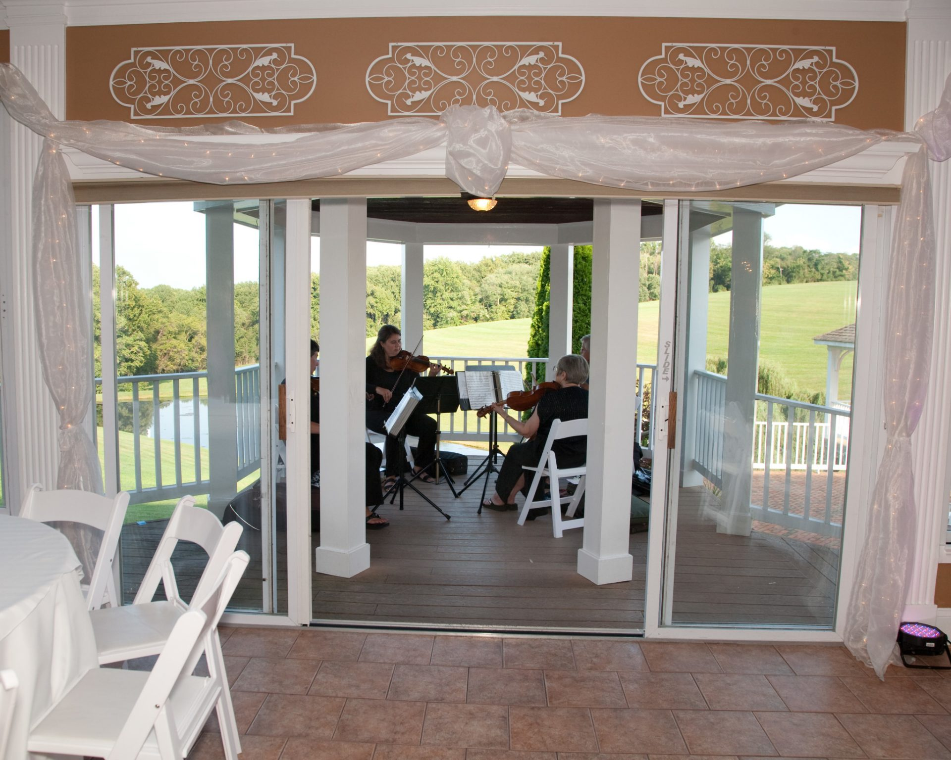 Band plays as wedding in maryland takes place on the pavilion