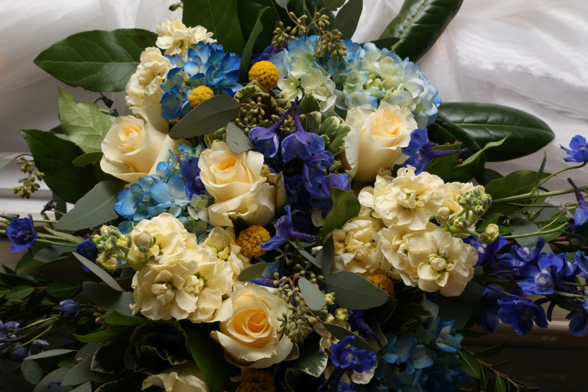 Yellow, blue and purple wedding flowers
