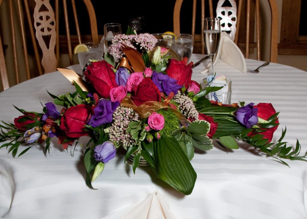 Wedding flower centerpiece on display at head table