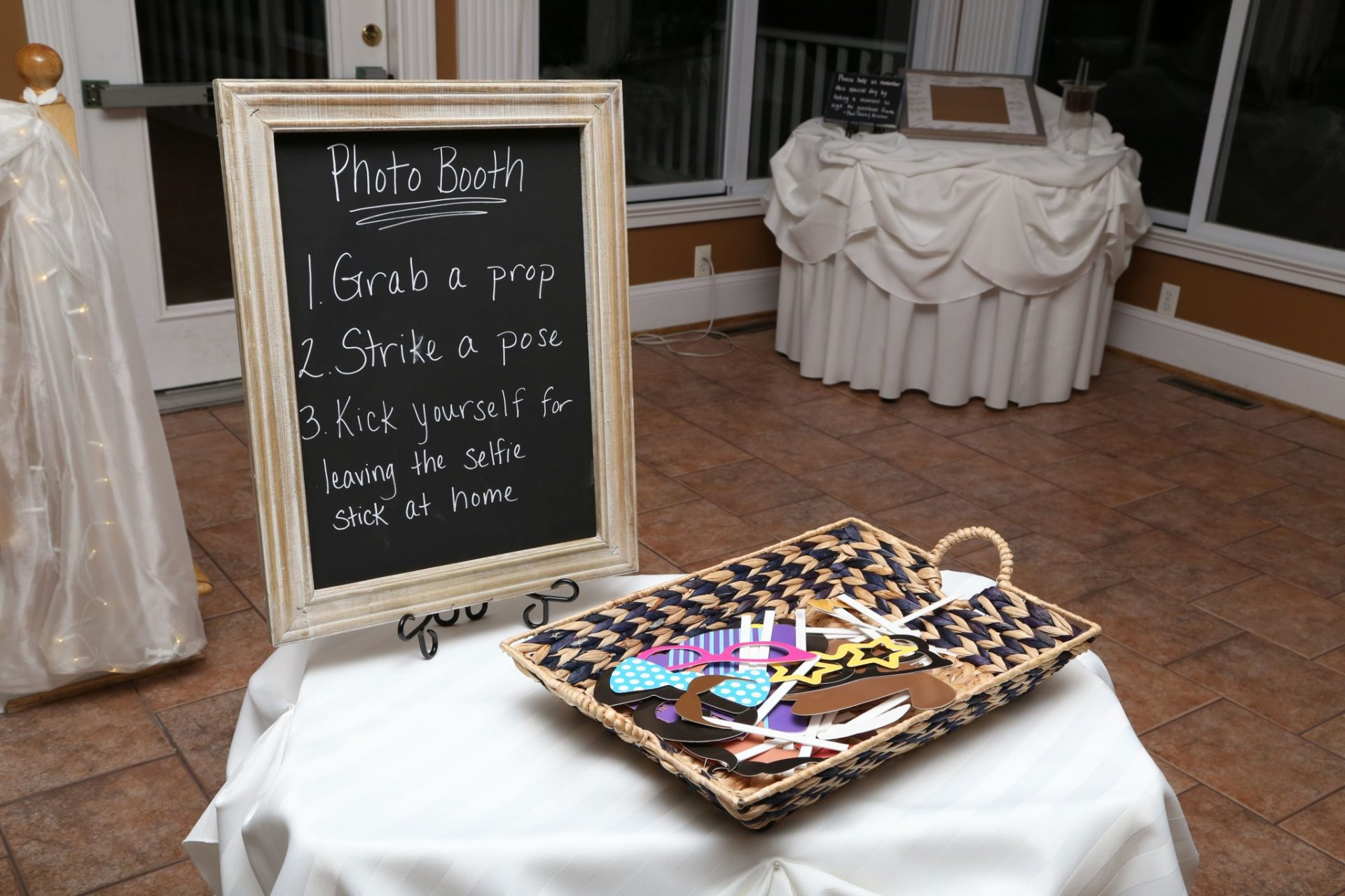 Many weddings in maryland have photo booths such as this one with fun props for guests to use.