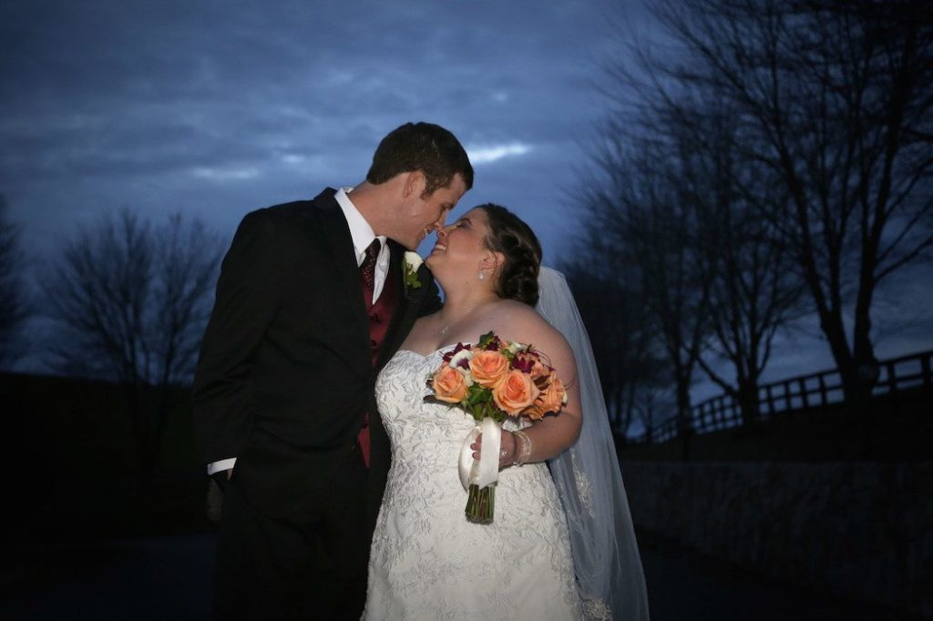 Bride and groom share a kiss outside of Morningside Inn after wedding