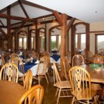 Dining room with large windows and seating for 200 guests