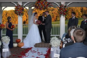 fall wedding venue in maryland, Morningside Inn provides awesome autumn wedding colors for photographs. Bride and groom on altar at their outdoor fall wedding ceremony