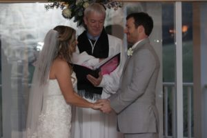 Vows during indoor wedding ceremony in Frederick MD