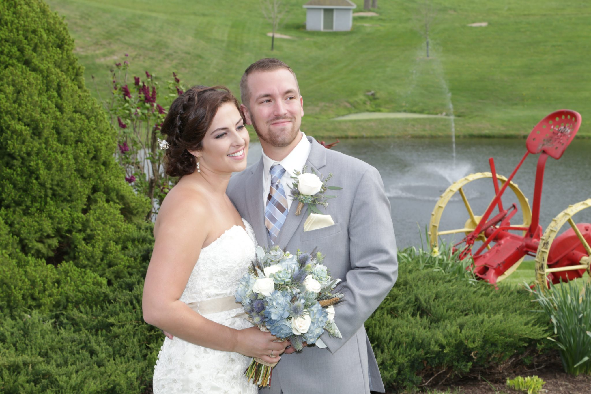 Bride and Groom pose by the ponds.
