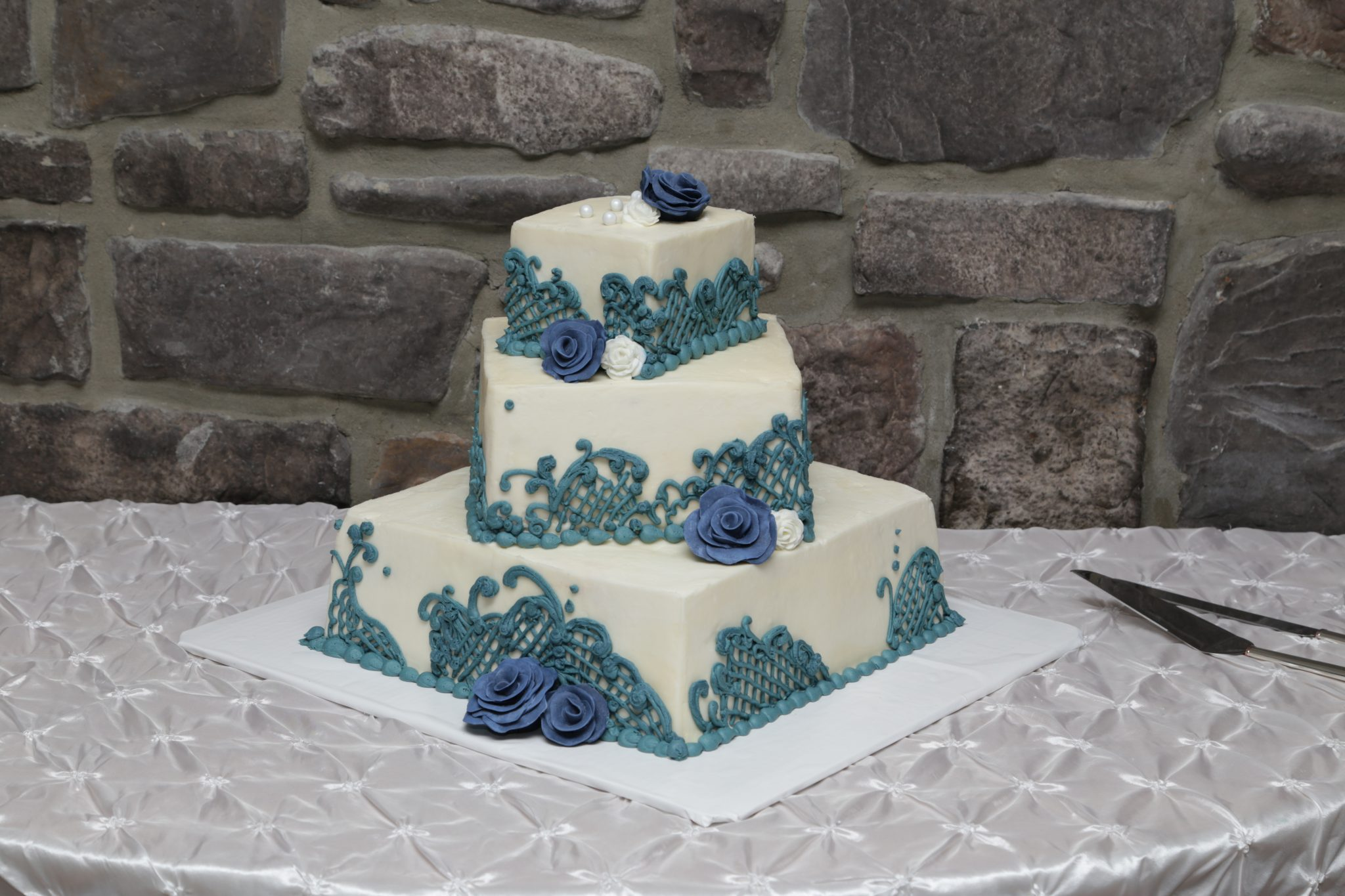 Country wedding cake with cream and blue icing
