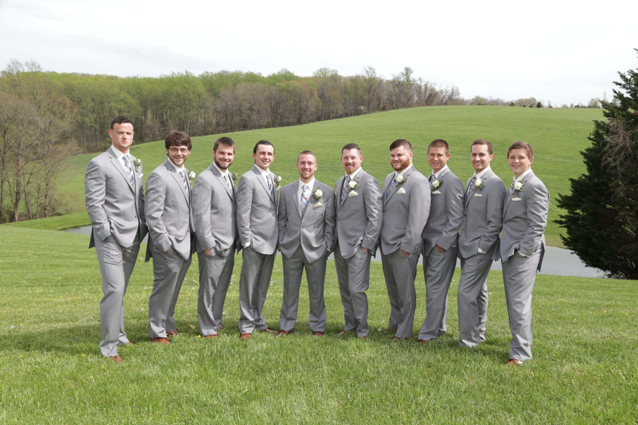 Groomsmen posed for photos on back lawn