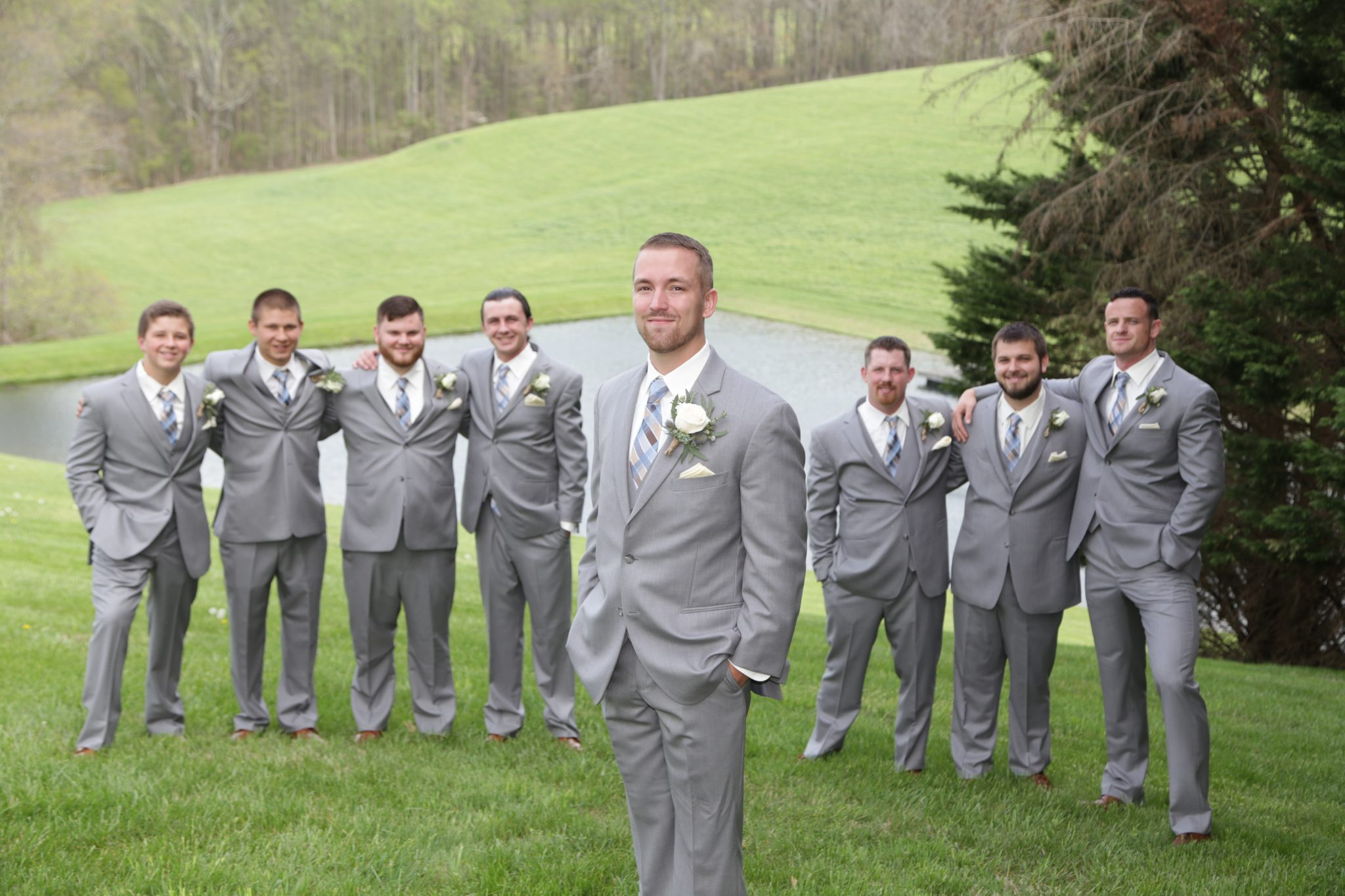 Groom and groomsmen pose on back lawn at Morningside Inn private estate wedding venue